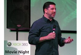 Scott Nocas, Xbox Live group product manager, talks to a crowd at a Microsoft promotional event.