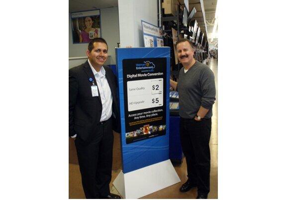 Walmart's Louis Greth and Universal's Craig Kornblau at Walmart April 11.