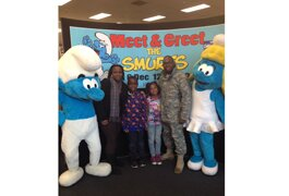 The Baggett family poses with Smurfette and Clumsy at Joint Base Lewis-McChord.