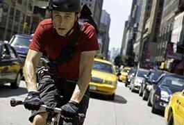 Josh Gordon-Levitt as bicycle messenger in