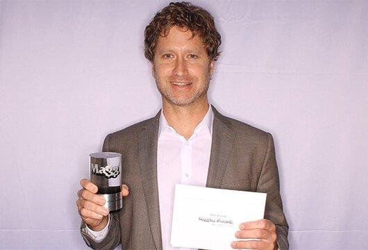 Associate publisher John Boezinger accepted the Maggie Award on behalf of 'Home Media Magazine'